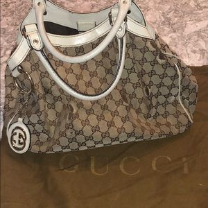 Authentic Gucci GG Medium Sukey